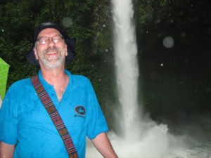 Randy visits a waterfall near the Arenal volcano.